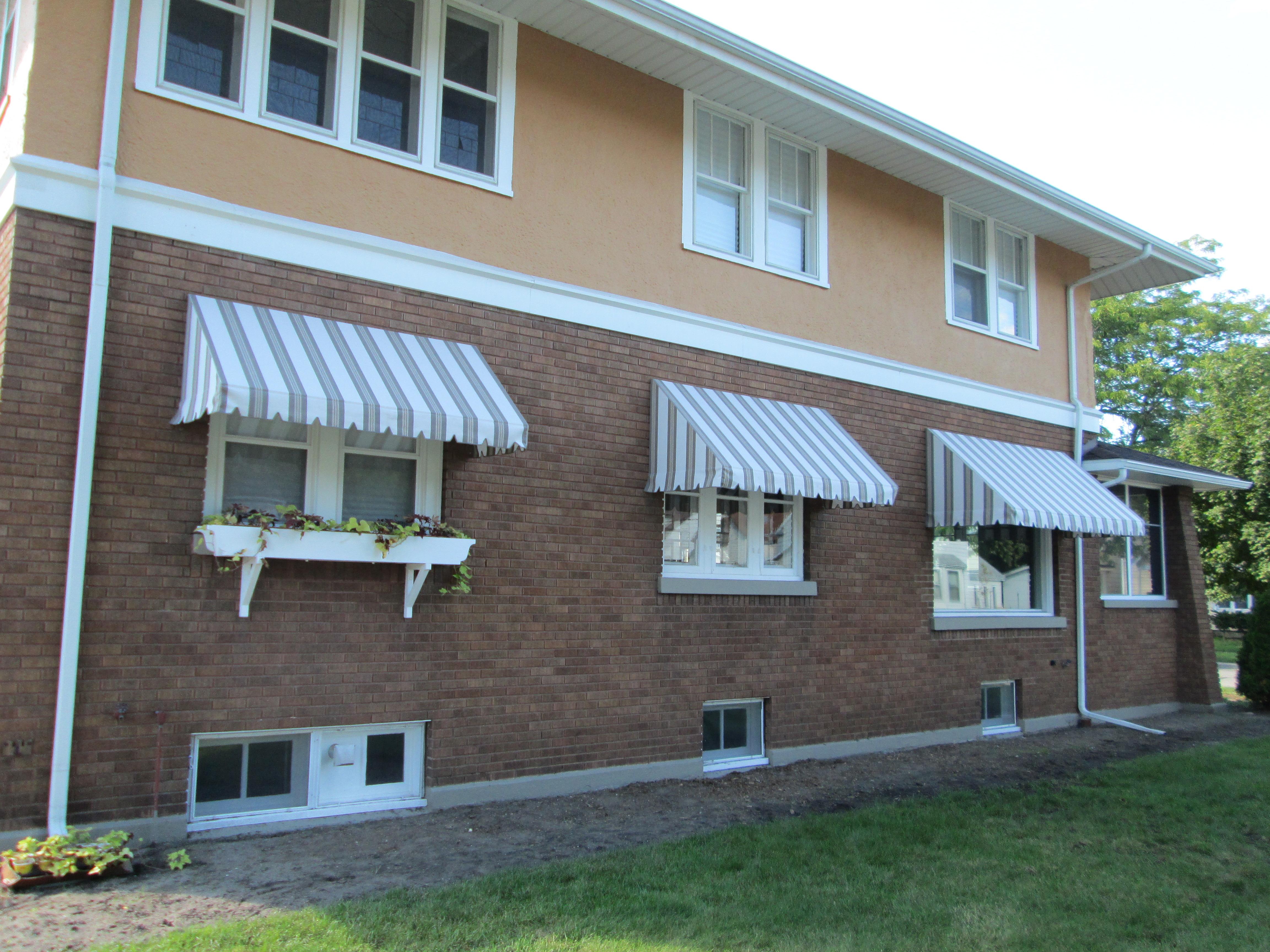 HOME-window-awnings-21 - Muskegon - Awning & Fabrication